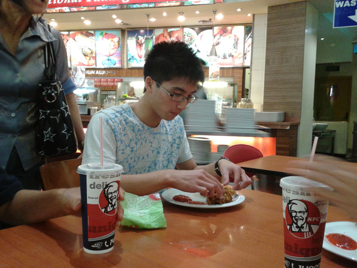 My brother enjoying cheap KFC XD
