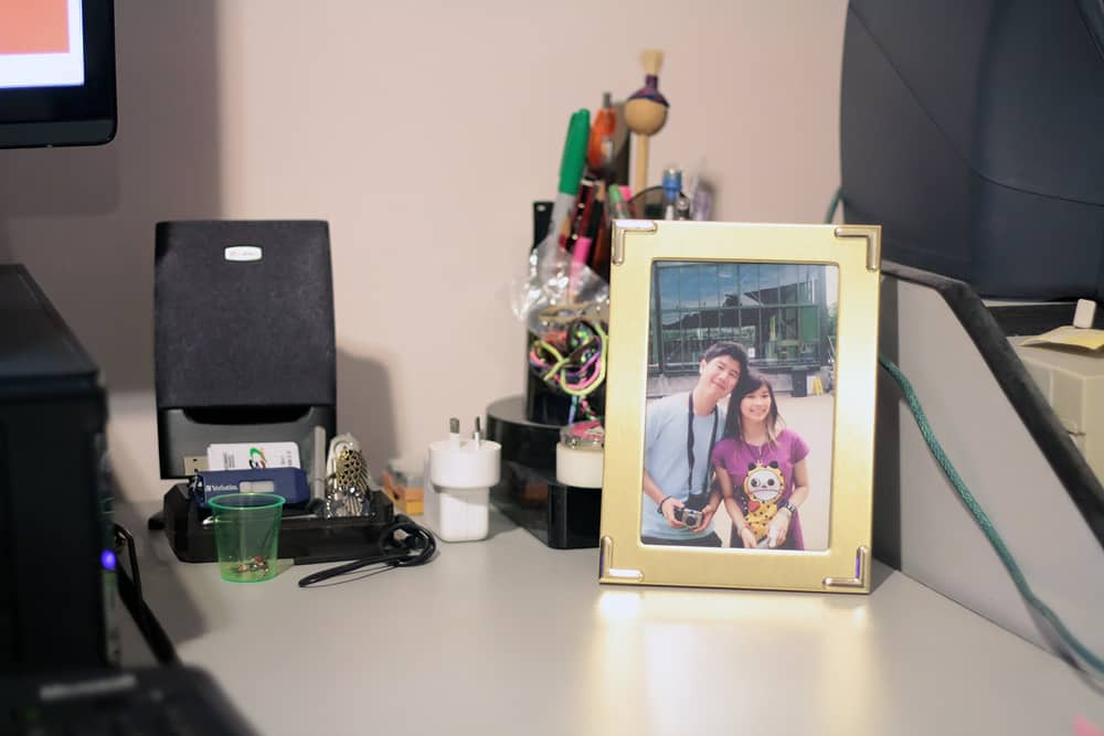 My desk, with a photo of me and James