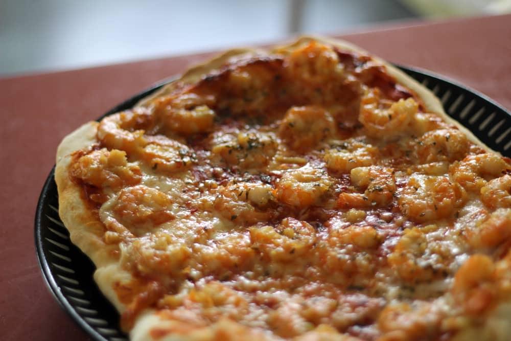 Homemade garlic prawn pizza