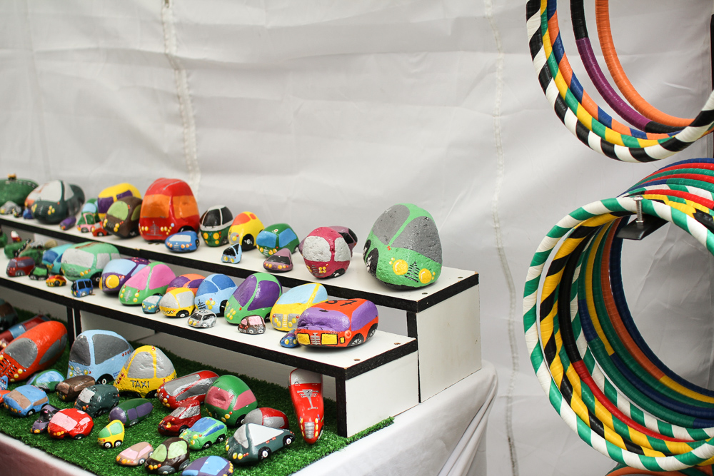 This little stall sold colourful resin accessories and painted rocks