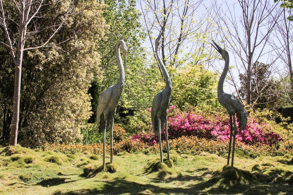 Three bird statues