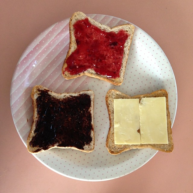 Breakfast: strawberry jam, Vegemite and cheese on toast