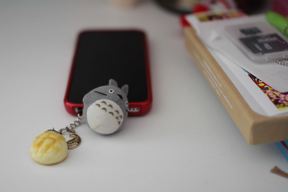 Totoro on my phone. And a melon pan (bread bun)