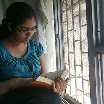 Bhairavee reading a book