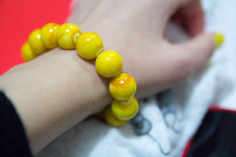 Bright yellow beaded bracelet