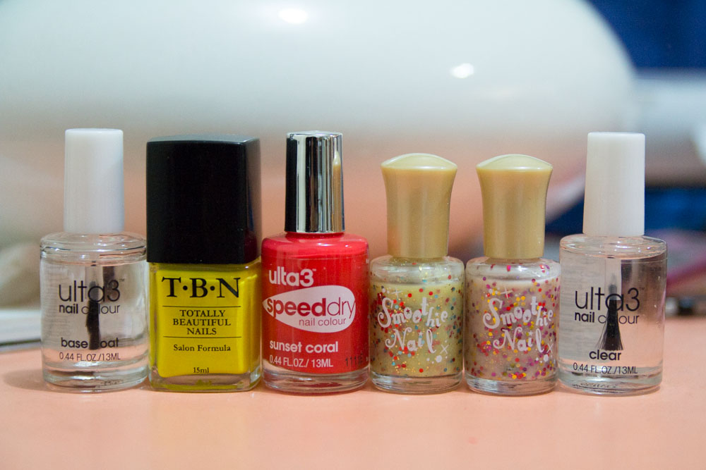 Ulta3 base coat; TBN in fluoro yellow, Ulta3 Speed Dry in Sunset Coral; Smoothie Nail (two variations); Ulta3 in Clear