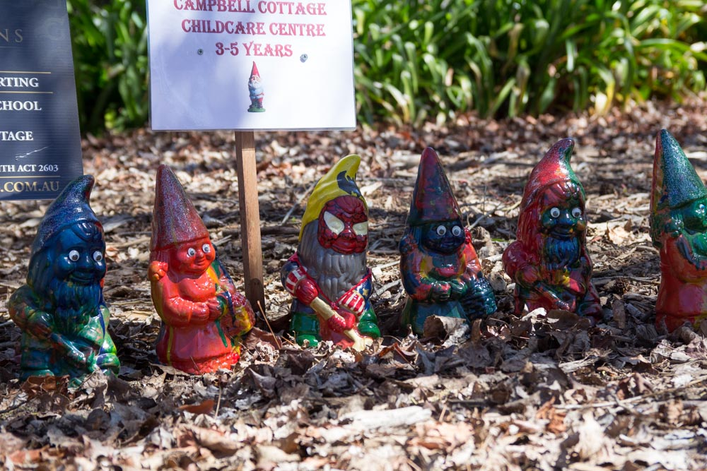 Some garden gnomes painted by children