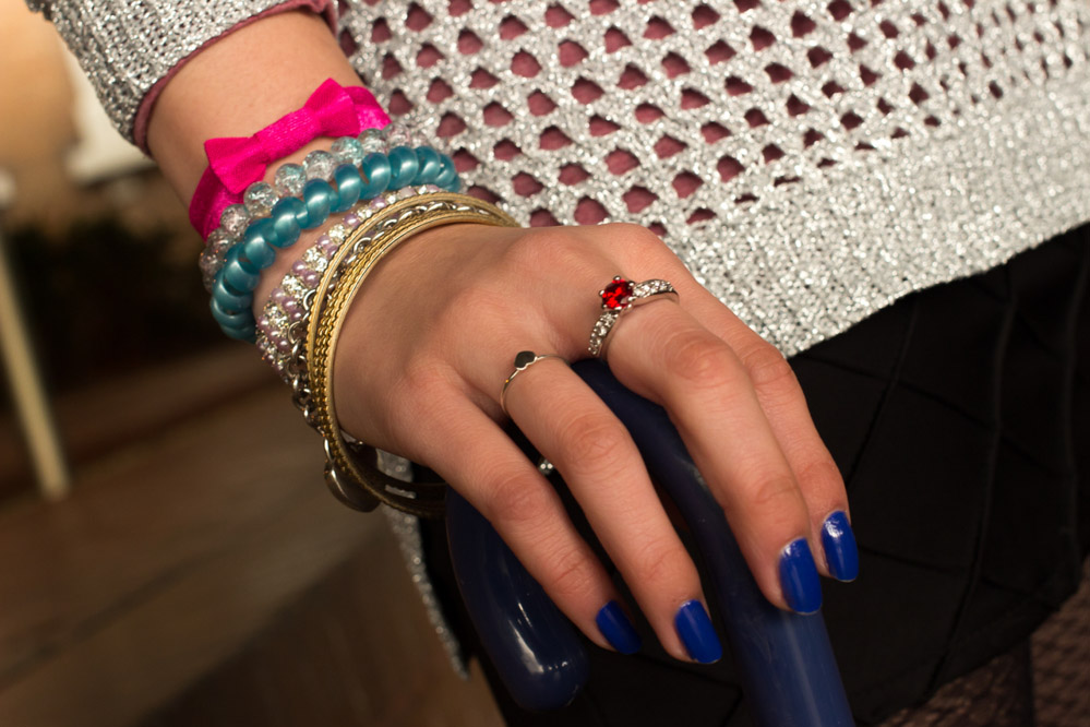 An arm party – bangles, bracelets, and a red ring