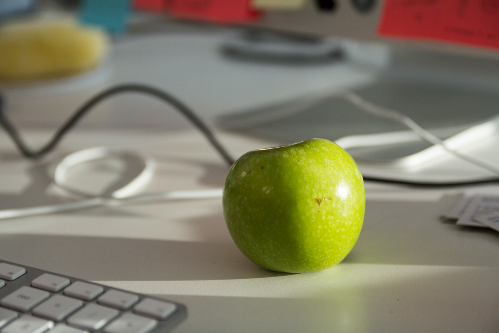 Apple on a desk