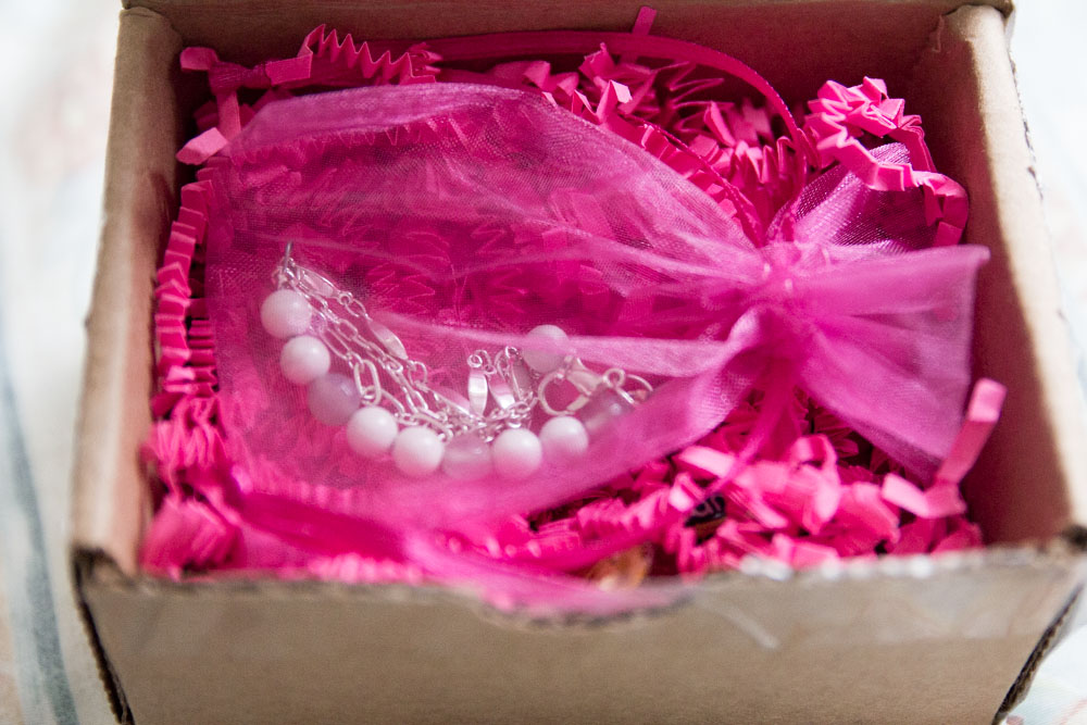 The bracelet in a pink organza bag