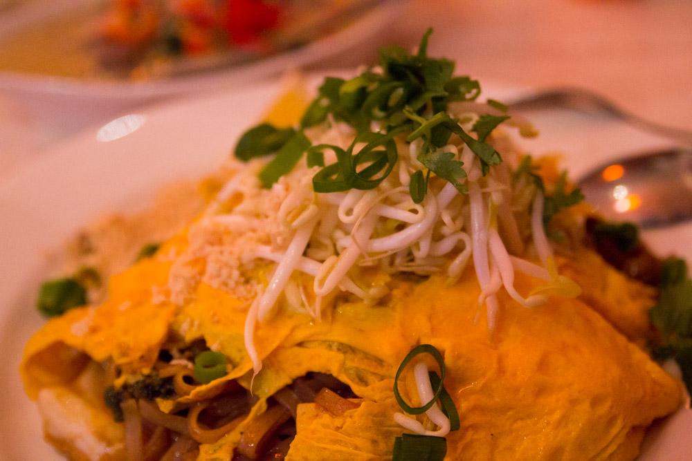 Omelette with stir-fried noodles and vegetables inside