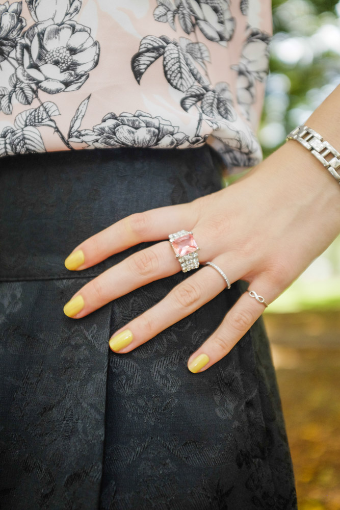Pink ring and yellow nails.