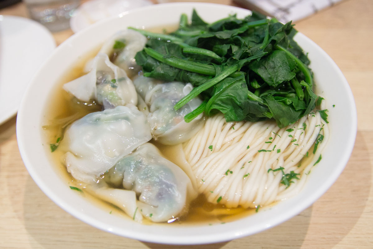 Vegetarian dumplings with noodles and spinach