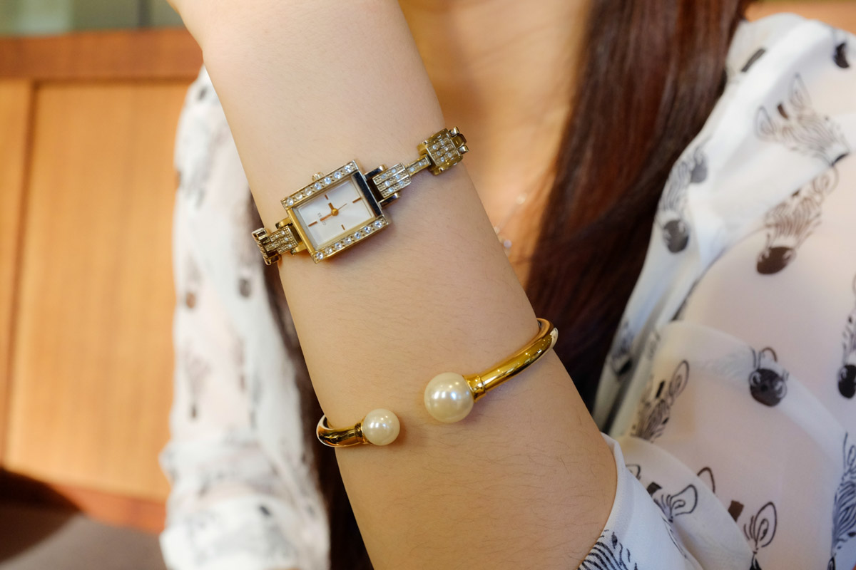 Pearl bangle and Guess watch