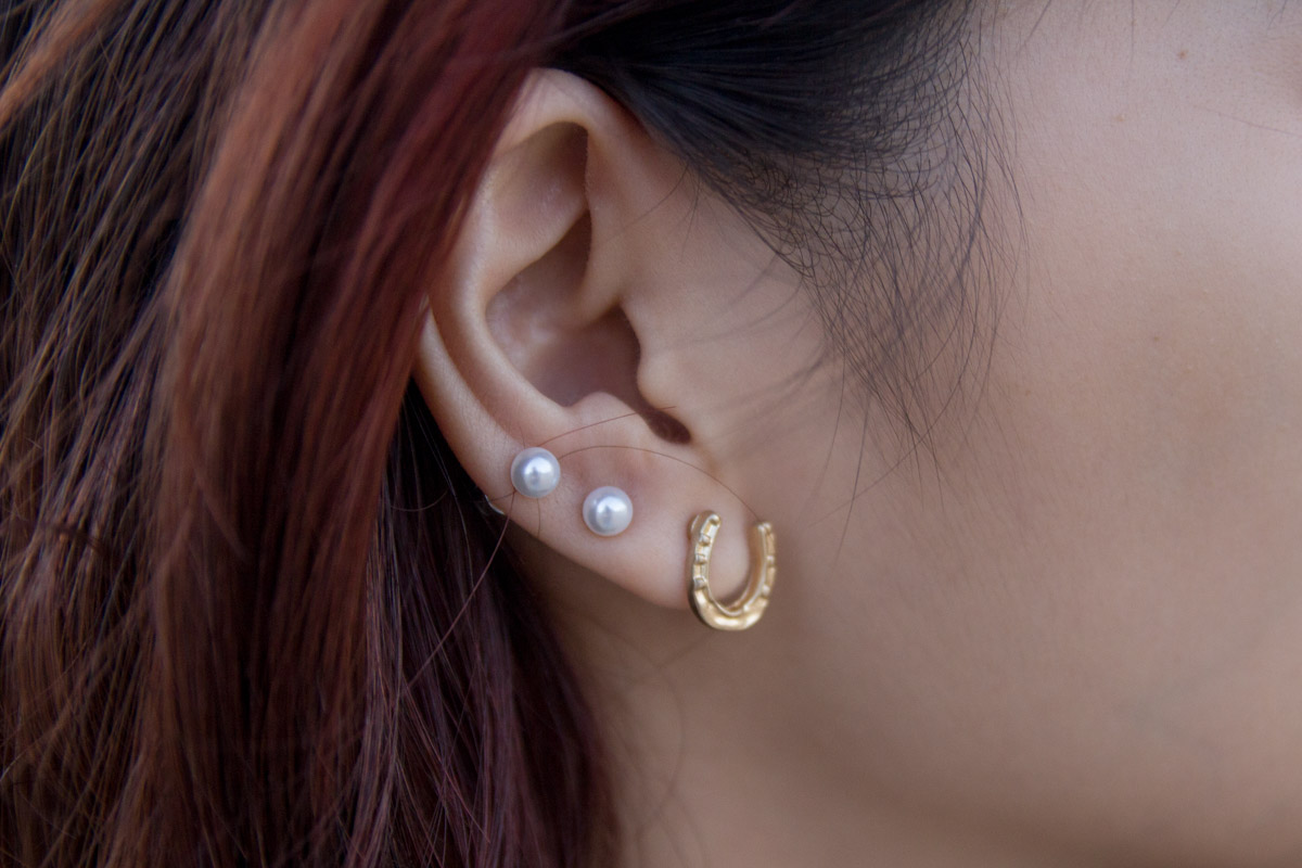 Horseshoe and pearl earrings