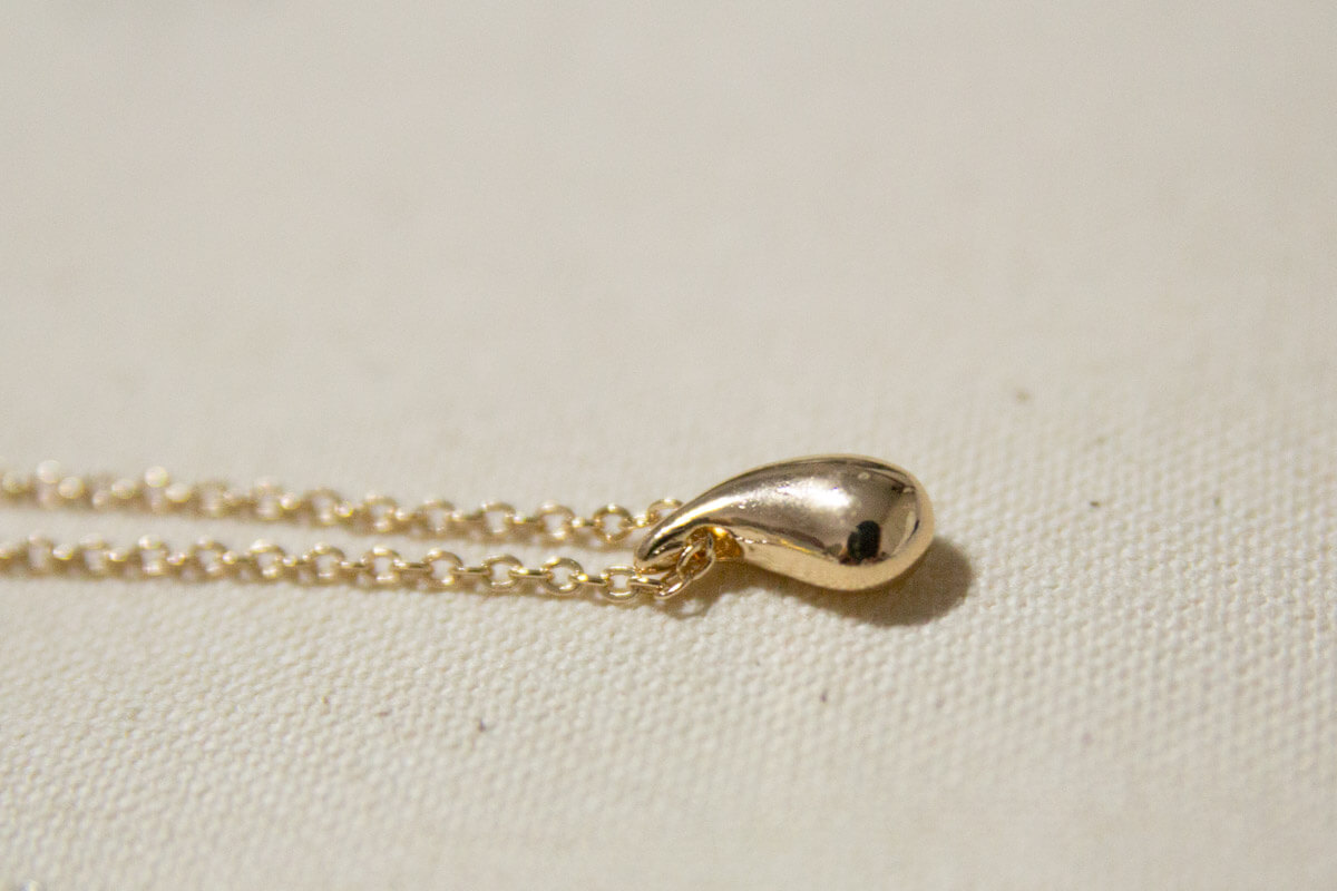 A close up of the drop necklace