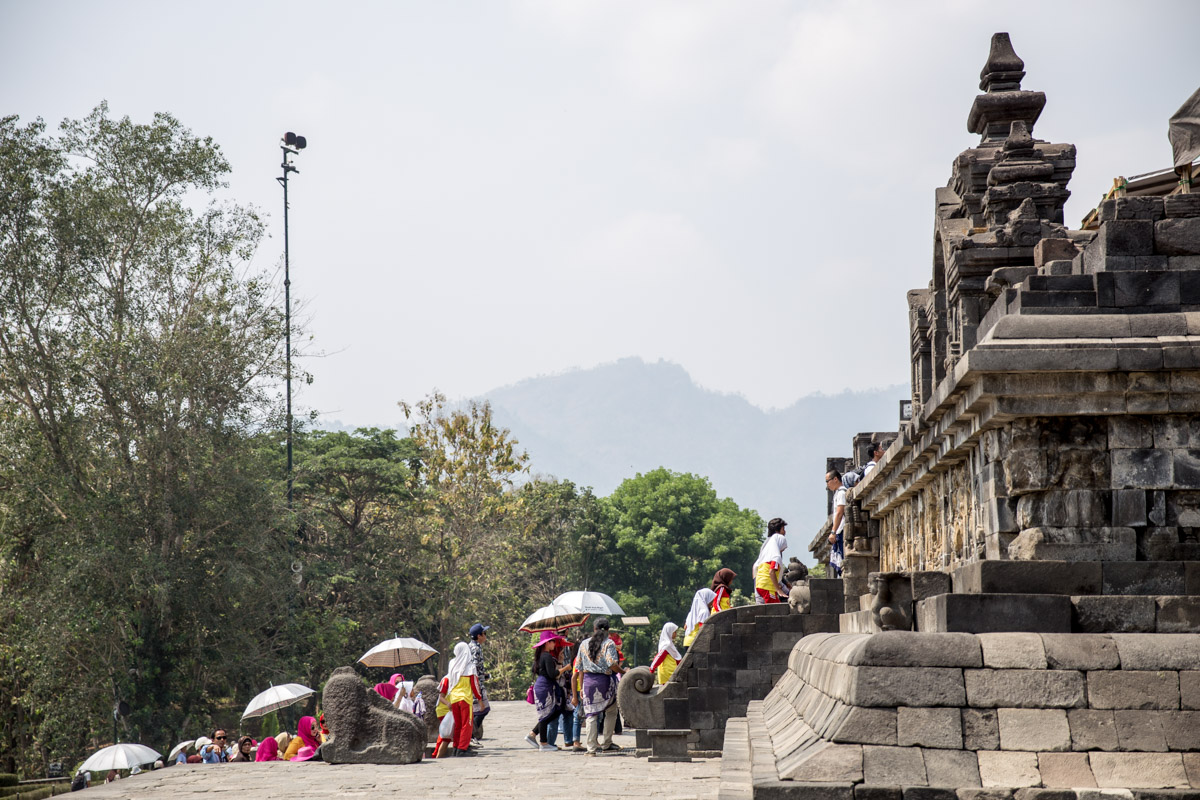 People approaching the steps to the temple