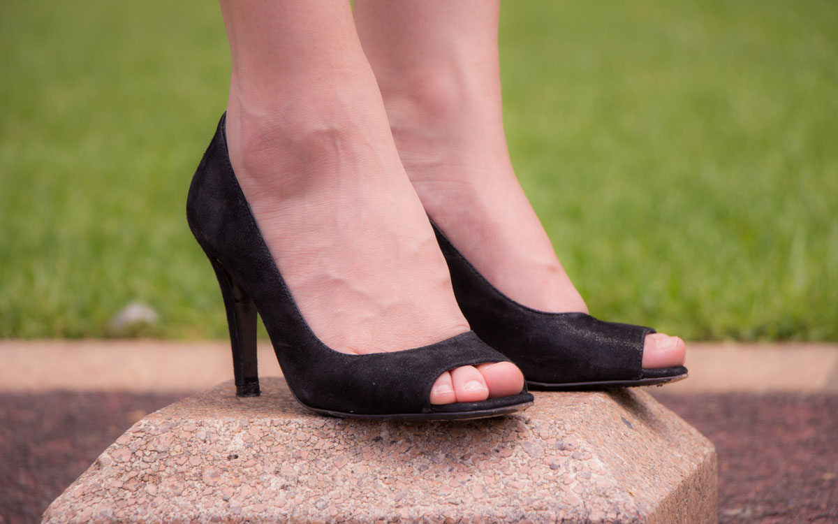 A close-up of my black peep-toe heels