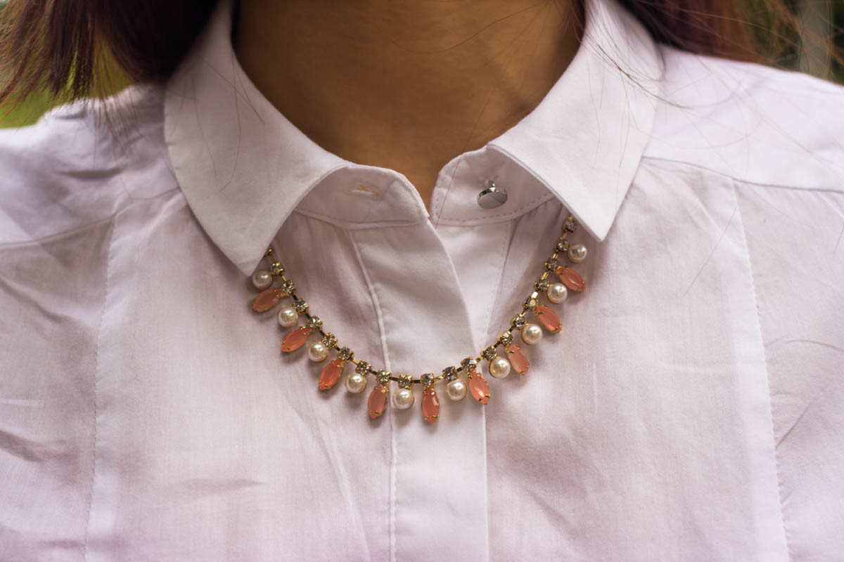 Close up of pink stone and pearl necklace