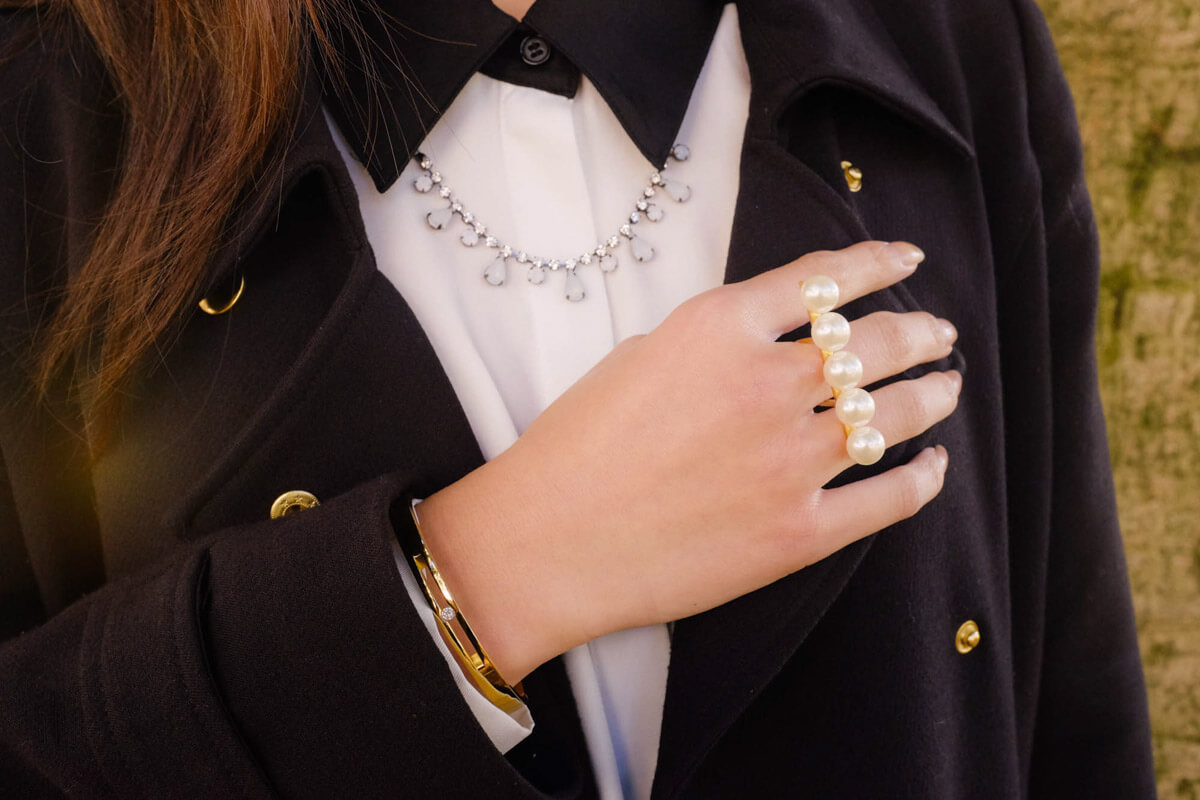 Close-up of ring, bangle and collar + necklace