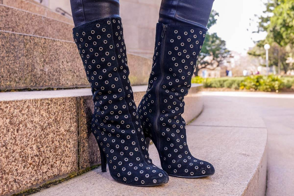 Heeled boots with silver round ring studs