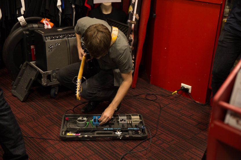 Ross fiddling with the guitar pedals.