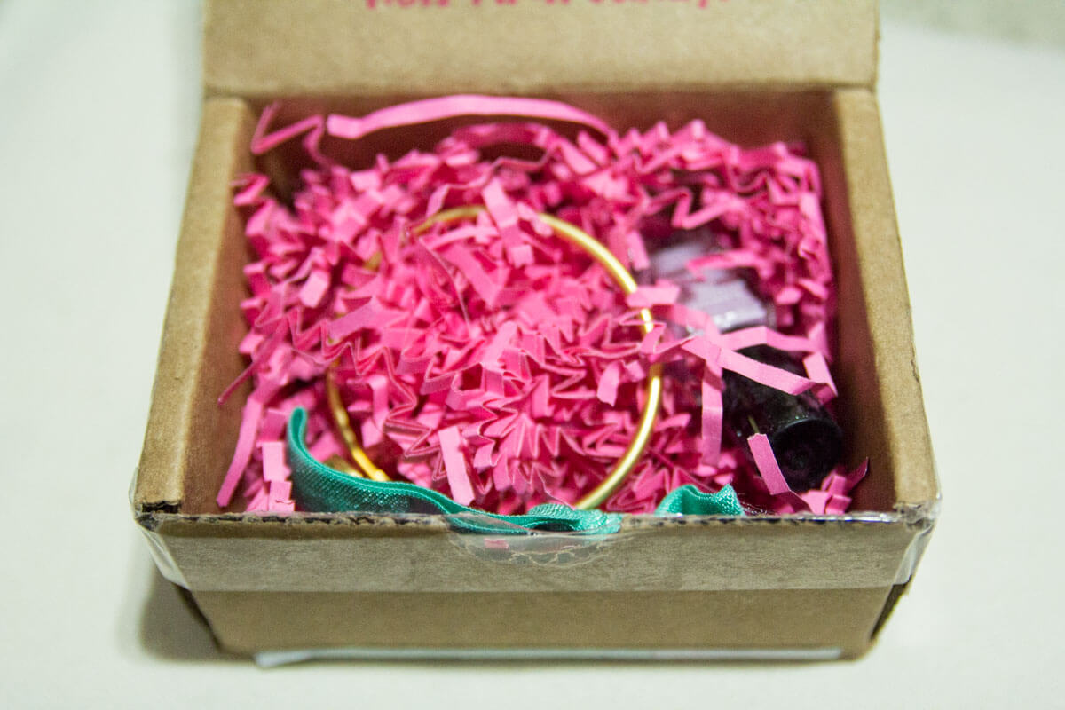 The contents of the box, packed with pink zigzag confetti