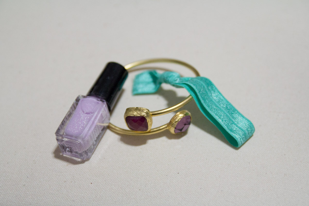 The bangle with the nail polish and hair tie