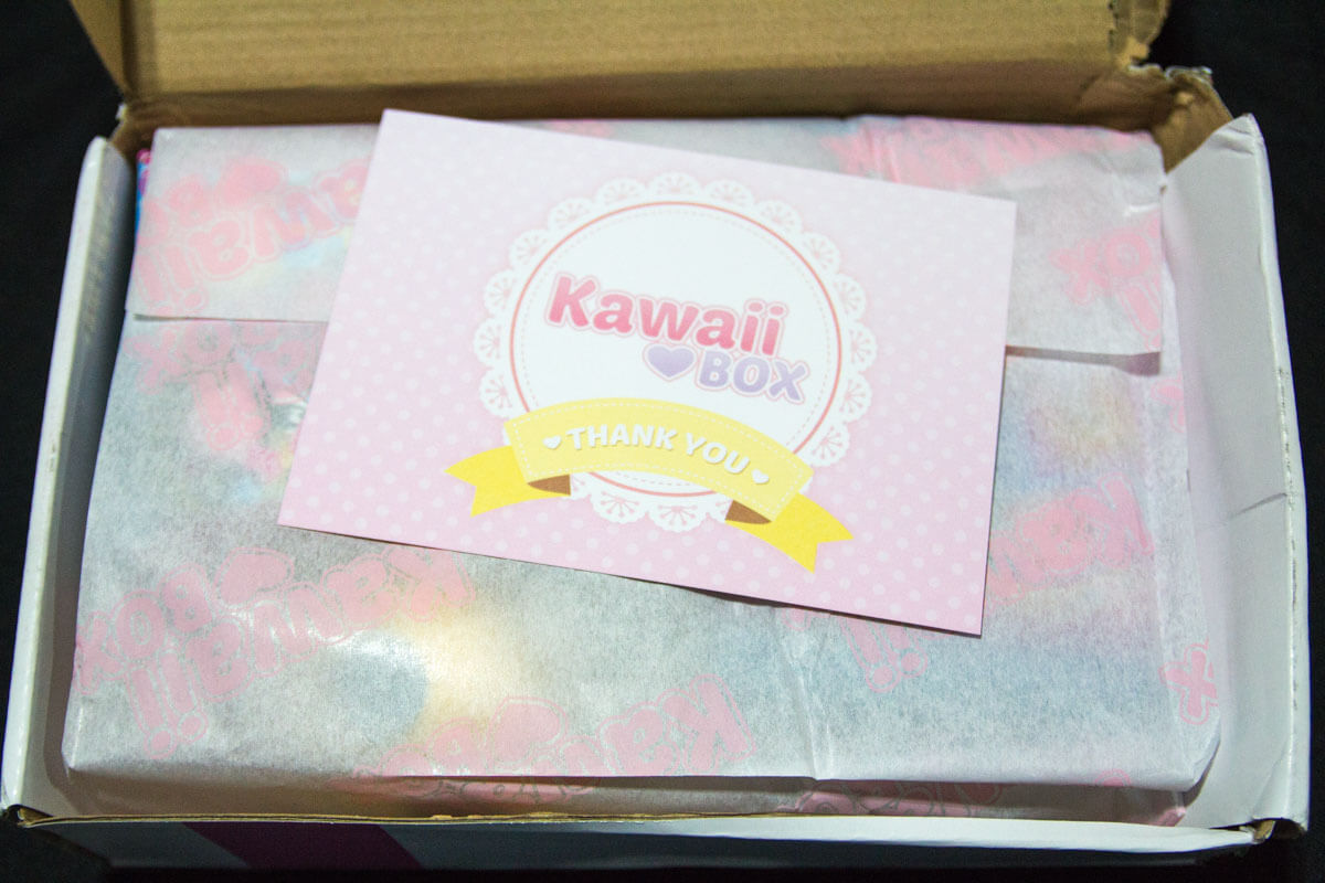 Greeting card and contents wrapped in tissue paper