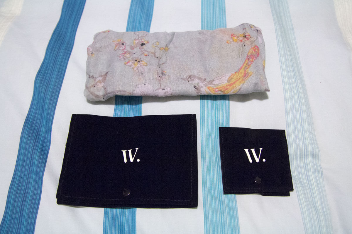 The jewellery pouches and the folded scarf