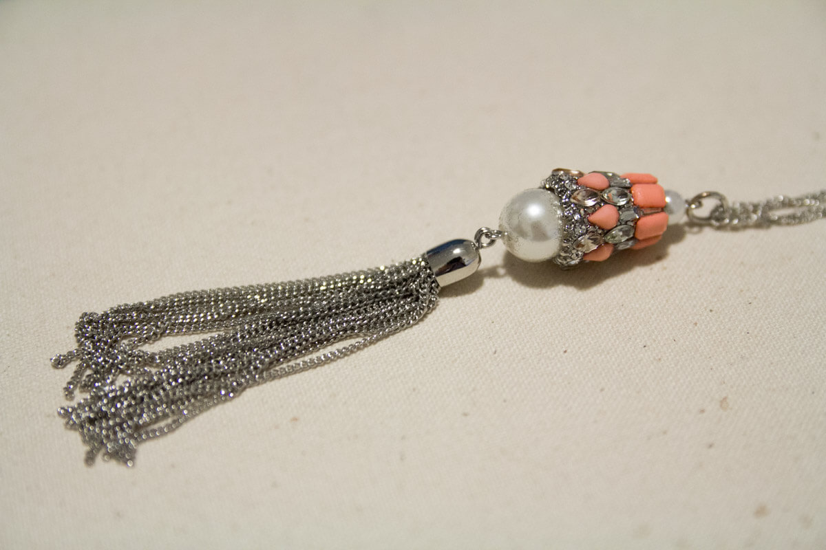 Another photo of the Char Necklace, showing its tassel